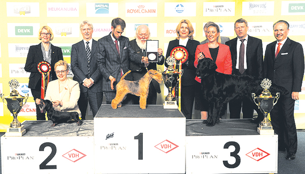 Best in Show at the International Dog Show VDH Europasieger (Dortmund) Germany, 6-8 May 2016 was the Lakeland Terrier, Aiola Von Den Schönen Bergen, owned by Friedrich Wilhelm Schöneberg from Germany. Handled by Juri Sokolic. Reserve was the Smooth-Haired Dachshund, Norden Light Triumph, owned by Artur Lewantowitsch from Germany and Third was the Flat Coated Retriever, Altaflats Ain't I'm A Dog, owned by Ida Wiesener from Norway. BIS?Judge was Ramune Kazlauskaite (Lithuania) pictured centre with BIS rosette. The presentation party included from left to right Christa Bremer (Vice President VDH), Vince Hogan OUR DOGS (International Media Partner), Peter Friedrich President of the VDH and Wolfgang Henke (Vice-President VDH).