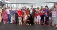 The stars of the day! Assembly Members, Marc Abraham and some owners with rescue dogs in Wales